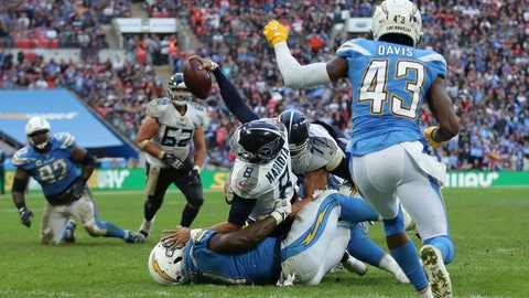 <p>               Tennessee Titans quarterback Marcus Mariota (8), center, goes over for a touchdown which was later disallowed during the second half of an NFL football game against Los Angeles Chargers at Wembley stadium in London, Sunday, Oct. 21, 2018. (AP Photo/Tim Ireland)             </p>