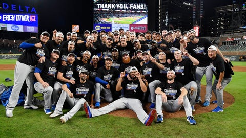 <p>               The Los Angeles Dodgers pose for a group portrait after an Game 4 of baseball's National League Division Series against the Atlanta Braves, Monday, Oct. 8, 2018, in Atlanta. The Los Angeles Dodgers won 6-2. (AP Photo/John Amis)             </p>