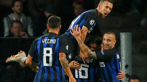 <p>               Inter midfielder Radja Nainggolan jumps on top of Inter midfielder Matteo Politano after they scored their side's second goal during a Group B Champions League soccer match between PSV and Inter Milan at the Philips stadium in Eindhoven, Netherlands, Wednesday, Oct. 3, 2018. (AP Photo/Peter Dejong)             </p>