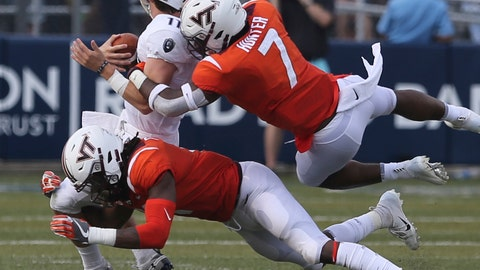 <p>               FILE - In this Sept. 22, 2018, file photo, Old Dominion's Blake LaRussa gets wrapped up by Virginia Tech's Devon Hunter (7) and Reggie Floyd (21) during the second half of an NCAA college football game, in Norfolk, Va. Virginia Tech's young defense has been equal to the task in many situations this season, but much on-the-job training also has been apparent. (AP Photo/Jason Hirschfeld, File)             </p>