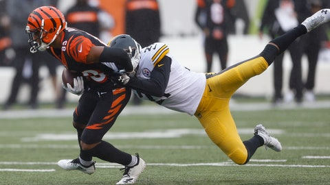 <p>               Cincinnati Bengals wide receiver Tyler Boyd (83) runs the ball against Pittsburgh Steelers free safety Sean Davis, right, in the first half of an NFL football game, Sunday, Oct. 14, 2018, in Cincinnati. (AP Photo/Gary Landers)             </p>
