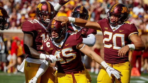 <p>               FILE - In this Sept. 15, 2018, file photo, Minnesota linebacker Carter Coughlin (45) celebrates his sack against Miami (Ohio) with Tai'yon Devers (12) and Julian Huff (20) in the first half of an NCAA football game, in Minneapolis.  Indiana and Minnesota will play in prime time with both teams badly needing a win to boost their bid for a bowl game, and Hoosiers quarterback Peyton Ramsey will test a Gophers secondary that has been picked apart in Big Ten play. (AP Photo/Bruce Kluckhohn, File)             </p>