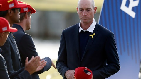 <p>               US team captain Jim Furyk attends the trophy ceremony after the European team won the 2018 Ryder Cup golf tournament at Le Golf National in Saint Quentin-en-Yvelines, outside Paris, France, Sunday, Sept. 30, 2018. (AP Photo/Alastair Grant)             </p>