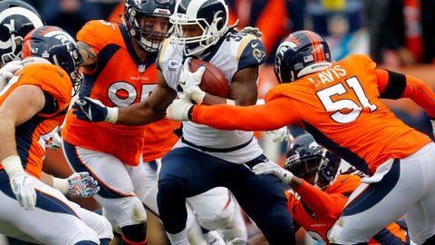 <p>               Los Angeles Rams running back Todd Gurley (30) runs as Denver Broncos linebacker Todd Davis (51) and defensive end Derek Wolfe (95) defend during the second half of an NFL football game, Sunday, Oct. 14, 2018, in Denver. (AP Photo/Joe Mahoney)             </p>