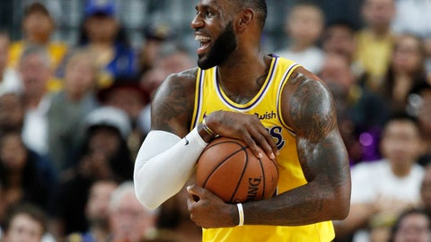 <p>               Los Angeles Lakers forward LeBron James reacts after a play against the Golden State Warriors during the first half of an NBA preseason basketball game Wednesday, Oct. 10, 2018, in Las Vegas. (AP Photo/John Locher)             </p>