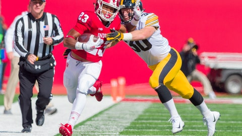 <p>               Indiana running back Ronnie Walker Jr. (23) runs the ball up the sideline as he's grabbed by Iowa defensive back Jake Gervase (30) during the first half of an NCAA college football game Saturday, Oct. 13, 2018, in Bloomington, Ind. (AP Photo/Doug McSchooler)             </p>