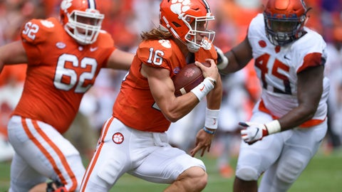 <p>               Clemson quarterback Trevor Lawrence scrambles out of the pocket with blocking help from Cade Stewart (62) as Syracuse's Kenneth Ruff chaes during the first half of an NCAA college football game Saturday, Sept. 29, 2018, in Clemson, S.C. Clemson won 27-23. (AP Photo/Richard Shiro)             </p>
