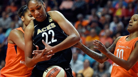 <p>               FILE - In this May 20, 2018, file photo, Las Vegas Aces forward A'ja Wilson (22) tries to get a rebound between Connecticut Sun forward Alyssa Thomas, left, and guard Courtney Williams during a WNBA basketball game, in Uncasville, Conn. Las Vegas Aces star Wilson provides a final diary from the FIBA Women's Basketball World Cup after the U.S. team's gold medal-winning performance.(Sean D. Elliot/The Day via AP, File)             </p>