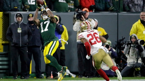 <p>               Green Bay Packers wide receiver Davante Adams (17) makes a catch against San Francisco 49ers cornerback Greg Mabin (26) during the second half of an NFL football game Monday, Oct. 15, 2018, in Green Bay, Wis. The Packers won 33-30. (AP Photo/Mike Roemer)             </p>