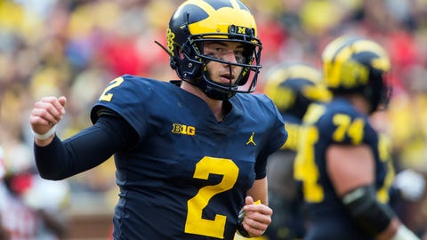 <p>               FILE - In this Saturday, Oct. 6, 2018, file photo, Michigan quarterback Shea Patterson (2) reacts after scoring a touchdown in the second quarter of an NCAA college football game against Maryland in Ann Arbor, Mich. No. 12 Michigan is undefeated since opening with a loss at Notre Dame, building momentum and confidence while waiting for its next opportunity to earn an impressive win. They won't have to wait much longer. No. 15 Wisconsin will come to play under the lights Saturday night at the Big House in what may prove to be a pivotal game in the conference's championship race.  (AP Photo/Tony Ding, File)             </p>