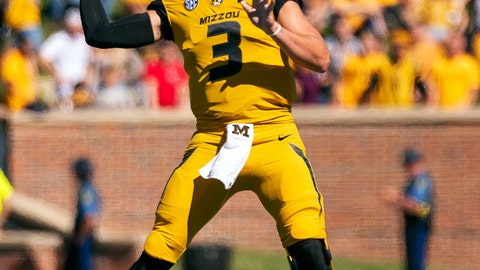 <p>               FILE - In this Saturday, Sept. 22, 2018, file phot, Missouri quarterback Drew Lock throws a pass during the first half of an NCAA college football game against Georgia in Columbia, Mo. The bye week came at a good time for Lock and Missouri, which hung with Georgia before mistakes wound up biting them. Missouri committed three turnovers and had a punt blocked that resulted in a touchdown. (AP Photo/L.G. Patterson)             </p>