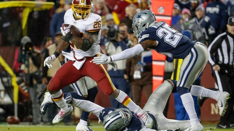 <p>               Washington Redskins running back Adrian Peterson (26) is chased by Dallas Cowboys free safety Xavier Woods (25) during the second half of an NFL football game, Sunday, Oct. 21, 2018 in Landover, Md. (AP Photo/Andrew Harnik)             </p>