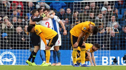 <p>               Brighton players, background celebrate victory as Wolverhampton Wanderers react at the end of their English Premier League soccer match at the AMEX Stadium, in Brighton, England, Saturday, Oct. 27 2018. (Gareth Fuller/PA via AP)             </p>