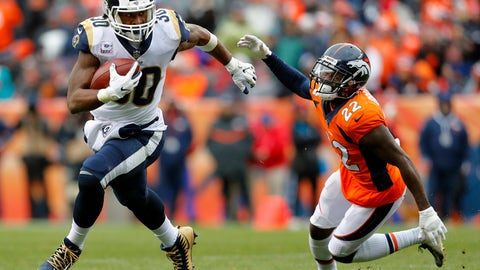 <p>               Los Angeles Rams running back Todd Gurley (30) breaks free from Denver Broncos defensive back Tramaine Brock (22) for a touchdown during the second half of an NFL football game, Sunday, Oct. 14, 2018, in Denver. (AP Photo/Joe Mahoney)             </p>