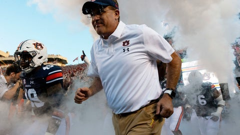 <p>               FILE - In this Saturday, Sept. 8, 2018, file photo, Auburn coach Gus Malzahn takes the field for the team's NCAA college football game against Alabama State, in Auburn, Ala. Malzahn, who just the season before seemed to be in a precarious position with Auburn, received a $49 million, seven-year contract that makes him the fifth-highest paid coach in college football this season, according to USA Today's salary database. (AP Photo/Vasha Hunt, File)             </p>