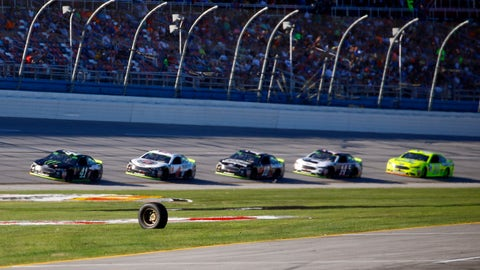 <p>               A tire from driver Corey LaJoie (72) rolls across the track, bringing out a caution, as the leaders led by driver Kurt Busch (41) pass by during the 1000Bulbs.com 500 NASCAR Cup Series auto race at Talladega Superspeedway, Sunday, Oct. 14, 2018, in Talladega, Ala. (AP Photo/Butch Dill)             </p>