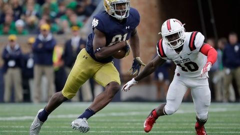 """<p>               FILE - In this Sept. 8, 2018, file photo, Notre Dame wide receiver Miles Boykin (81) runs with the ball against Ball State during the second half of an NCAA college football game in South Bend, Ind. Notre Dame won 24-16. Boykin is usually the tallest guy in a classroom at Notre Dame. The Irish offensive huddle is another matter. """"Once we had Chase (Claypool), Cole (Kmet), Alizé (Mack) and me, and I'm the smallest receiver out there on the field,"""" said the 6-foot-4, 228-pound senior wideout, one of the shortest of six Notre Dame receivers and tight ends. Notre Dame plays Pittsburgh this week. (AP Photo/Nam Y. Huh, File)             </p>"""