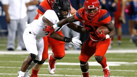 <p>               Arizona running back J.J. Taylor (21) stiff arms an Oregon defender in the first half during an NCAA college football game, Saturday, Oct. 27, 2018, in Tucson, Ariz. (AP Photo/Rick Scuteri)             </p>