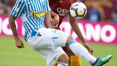 <p>               Spal's Alberto Paloschi, left, vies for the ball with Steven Nzonzi of Roma during the Italian Serie A soccer match between Roma and Spal, at Olimpico stadium in Rome, Italy, Saturday, Oct. 20, 2018. (Maurizio Brambatti/ANSA via AP)             </p>