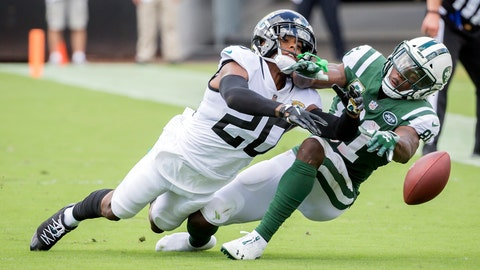<p>               Jacksonville Jaguars cornerback Jalen Ramsey (20) breaks up a pass intended for New York Jets wide receiver Quincy Enunwa, right, during the first half of an NFL football game, Sunday, Sept. 30, 2018, in Jacksonville, Fla. (AP Photo/Stephen B. Morton)             </p>