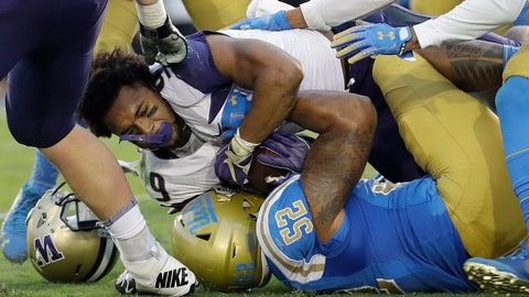 <p>               Washington running back Myles Gaskin, top, loses his helmet as he is tackled by UCLA linebacker Lokeni Toailoa (52) during the first half of an NCAA college football game Saturday, Oct. 6, 2018, in Pasadena, Calif. (AP Photo/Marcio Jose Sanchez)             </p>
