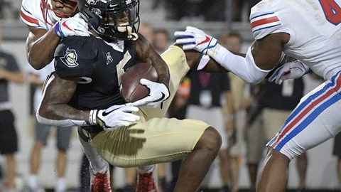 <p>               UCF wide receiver Dredrick Snelson (5) catches a pass in the end zone for a 14-yard touchdown between SMU defensive back Rodney Clemons, left, and safety Mikial Onu (4) during the first half of an NCAA college football game Saturday, Oct. 6, 2018, in Orlando, Fla. (AP Photo/Phelan M. Ebenhack)             </p>