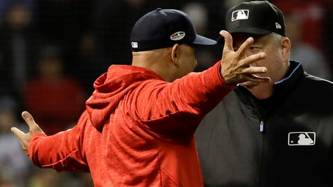 <p>               Boston Red Sox manager Alex Cora argues a strike three call with umpire Joe West during the fifth inning in Game 1 of a baseball American League Championship Series against the Houston Astros on Saturday, Oct. 13, 2018, in Boston. (AP Photo/David J. Phillip)             </p>
