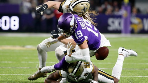 <p>               Minnesota Vikings wide receiver Adam Thielen (19) fumbles the ball as he is hit by New Orleans Saints linebacker Alex Anzalone, rear, and cornerback P.J. Williams, bottom, during the first half of an NFL football game, Sunday, Oct. 28, 2018, in Minneapolis. (AP Photo/Bruce Kluckhohn)             </p>