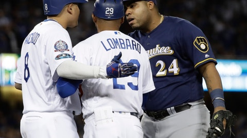 <p>               Milwaukee Brewers' Jesus Aguilar and Los Angeles Dodgers' Manny Machado have words during the 10th inning of Game 4 of the National League Championship Series baseball game Tuesday, Oct. 16, 2018, in Los Angeles. (AP Photo/Matt Slocum)             </p>