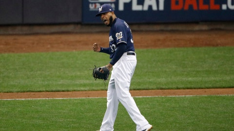 <p>               Milwaukee Brewers relief pitcher Jeremy Jeffress (32) reacts after a double play during the seventh inning of Game 2 of the National League Championship Series baseball game against the Los Angeles Dodgers Saturday, Oct. 13, 2018, in Milwaukee. (AP Photo/Charlie Riedel)             </p>