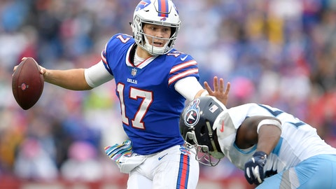 <p>               Buffalo Bills quarterback Josh Allen, left, tries to avoid a tackle from Tennessee Titans linebacker Sharif Finch during the second half of an NFL football game, Sunday, Oct. 7, 2018, in Orchard Park, N.Y. (AP Photo/Adrian Kraus)             </p>