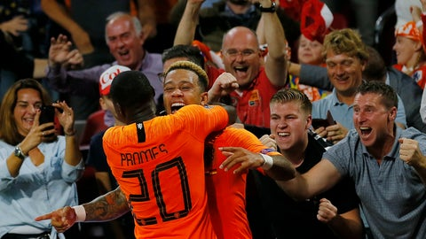 <p>               Netherland's Memphis Depay, center, celebrates with Netherland's Quincy Promes, left, and supporters after he scored his side's second goal during the UEFA Nations League soccer match between The Netherlands and Germany at the Johan Cruyff ArenA in Amsterdam, Saturday, Oct. 13, 2018. (AP Photo/Peter Dejong)             </p>