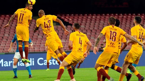 <p>               Roma's Aleksandar Kolarov, left, clears the ball during the Serie A soccer match between Napoli and Roma, at the San Paolo stadium in Naples, Italy, Sunday, Oct. 28, 2018. (Cesare Abbate/ANSA via AP)             </p>
