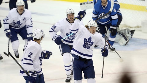 <p>               Toronto Maple Leafs' Patrick Marleau (12), Ron Hainsey (2), Auston Matthews (34) and Kasperi Kapanen (24) celebrate after Kapanen scored on Winnipeg Jets goaltender Connor Hellebuyck (37) during first period NHL hockey action in Winnipeg, Wednesday, Oct. 24, 2018. (Trevor Hagan/The Canadian Press via AP)             </p>