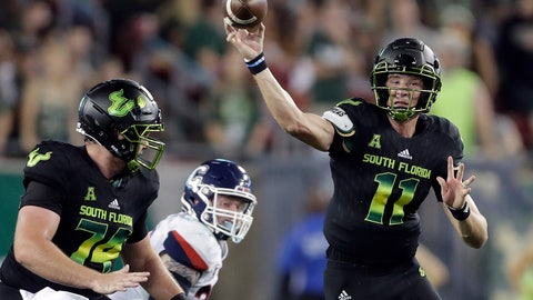 <p>               South Florida quarterback Blake Barnett (11) fires a pass against Connecticut during the first half of an NCAA college football game Saturday, Oct. 20, 2018, in Tampa, Fla. (AP Photo/Chris O'Meara)             </p>