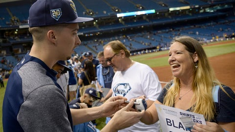 <p>               Tampa Bay Rays pitcher Blake Snell (4) signs an autograph after a baseball game against the Toronto Blue Jays Sunday, Sept. 30, 2018, in St. Petersburg, Fla. (AP Photo/Jason Behnken)             </p>