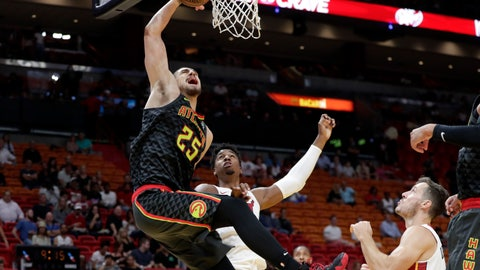 <p>               Atlanta Hawks' Alex Len (25) goes to the basket past Miami Heat's Hassan Whiteside, center, and Goran Dragic, right, during the first half of a preseason NBA basketball game, Friday, Oct. 12, 2018, in Miami. (AP Photo/Lynne Sladky)             </p>