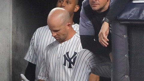 <p>               New York Yankees manager Aaron Boone watches play from the dugout during the seventh inning of Game 4 of baseball's American League Division Series against the Boston Red Sox, Tuesday, Oct. 9, 2018, in New York. (AP Photo/Julie Jacobson)             </p>