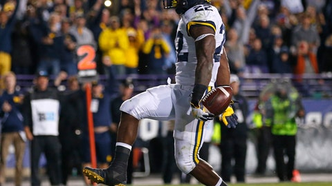 <p>               Michigan's Karan Higdon runs in to score a touchdown against Northwestern during the second half of an NCAA college football game Saturday, Sept. 29, 2018, in Evanston, Ill. (AP Photo/Jim Young)             </p>