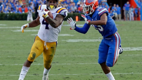 <p>               LSU running back Nick Brossette (4) runs for 46 yards before he is run out of bounds by Florida safety Donovan Stiner, right, during the second half of an NCAA college football game Saturday, Oct. 6, 2018, in Gainesville, Fla. (AP Photo/John Raoux)             </p>