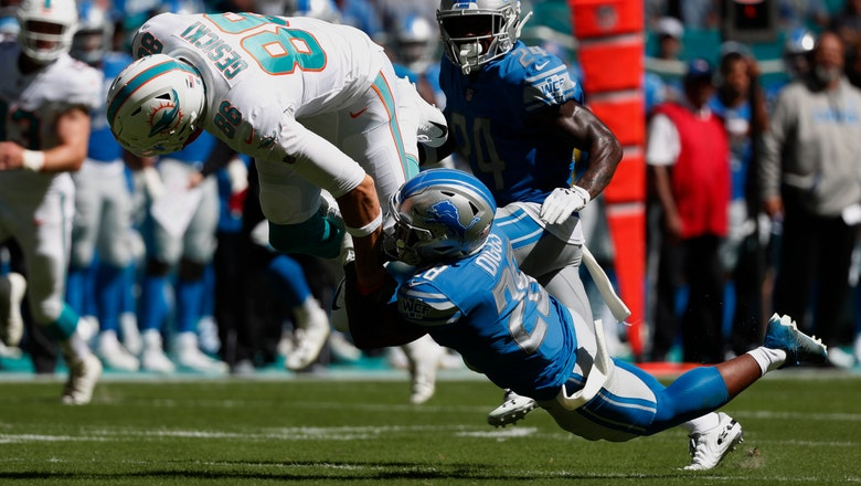 Lions climb to .500 by beating Dolphins 32-21
