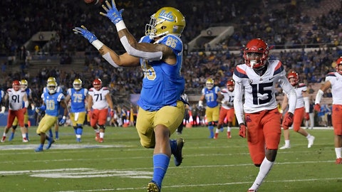 <p>               UCLA tight end Devin Asiasi, left, makes a touchdown catch as Arizona cornerback McKenzie Barnes watches during the first half of an NCAA college football game, Saturday, Oct. 20, 2018, in Pasadena, Calif. (AP Photo/Mark J. Terrill)             </p>