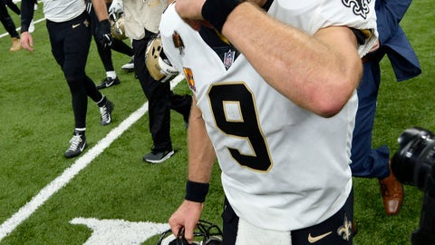 <p>               New Orleans Saints quarterback Drew Brees (9) wipes his eyes as he crosses the field after an NFL football game in New Orleans, Monday, Oct. 8, 2018. Brees broke the NFL all-time passing yards record during the game. The Saints won 43-19. (AP Photo/Bill Feig)             </p>
