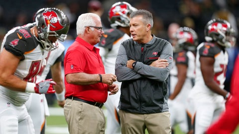 "<p>               FILE - In this Nov. 5, 2017, file photo, Tampa Bay Buccaneers defensive coordinator Mike Smith, left, talks with head coach Dirk Koetter before an NFL football game against the New Orleans Saints, in New Orleans. The Bucs' defensive woes have put the heat on coordinator Mike Smith, a former head coach of the Falcons. But head coach Dirk Koetter has resisted calls to make a change. ""Every week, every game, it's way bigger than any one guy,"" Koetter said. ""It's never all one person's fault and it's never all one person's credit."" (AP Photo/Butch Dill, File)             </p>"