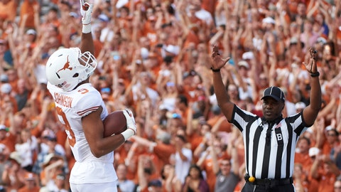 <p>               FILE- In this Saturday, Oct. 6, 2018, file photo, Texas wide receiver Collin Johnson (9) celebrates after scoring a touchdown on a 2-yard reception during the first half of an NCAA college football game against Oklahoma at the Cotton Bowl in Dallas. Johnson and Lil'Jordan Humphrey have been a big problem for opposing defenses. The duo has combined for 65 catches and eight touchdowns for the No. 9 Longhorns. (AP Photo/Cooper Neill, File)             </p>