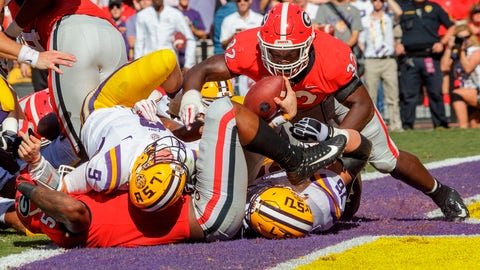 <p>               LSU quarterback Joe Burrow (9) scores a touchdown during the first half of an NCAA college football game against Georgia in Baton Rouge, La., Saturday, Oct. 13, 2018. (AP Photo/Matthew Hinton)             </p>