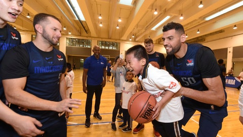 <p>               In a photo provided by NBAE, Dallas Mavericks center Salah Mejri, of Tunisia, lifts a participant during the NBA Cares Special Olympics Basketball Clinic, Thursday, Oct. 4, 2018, at Oriental Sports Center in Shanghai. At left is Mavericks guard J.J. Barea. (Randy Belice/NBAE via AP)             </p>