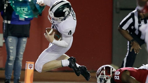 """<p>               FILE - In this Saturday, Sept. 22, 2018, file photo, Michigan State's Matt Coghlin (4) dives for a touchdown against Indiana's A'Shon Riggins during the second half of an NCAA college football game in Bloomington, Ind. MSU's quarterback Brian Lewerke, who also serves as holder, took off running on a fake field goal play called """"Rocks"""" and pitched to kicker Matt Coghlin to finish a 6-yard touchdown in a 35-21 win over Indiana. (AP Photo/Darron Cummings, File)             </p>"""
