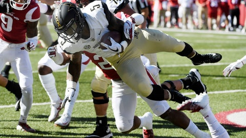<p>               Vanderbilt running back Ke'Shawn Vaughn is tripped up by an Arkansas defender in the first half of an NCAA college football game Saturday, Oct. 27, 2018, in Fayetteville, Ark. (AP Photo/Michael Woods)             </p>