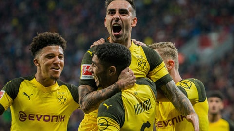 <p>               In this Sept. 29, 2018 photo Dortmund's Paco Alcacer, top, celebrates with Achraf Hakim, front, and Jadon Sancho after scoring his side's third goal in the German Bundesliga soccer match between Bayer 04 Leverkusen and Borussia Dortmund. (Rolf Vennenbernd/dpa via AP)             </p>